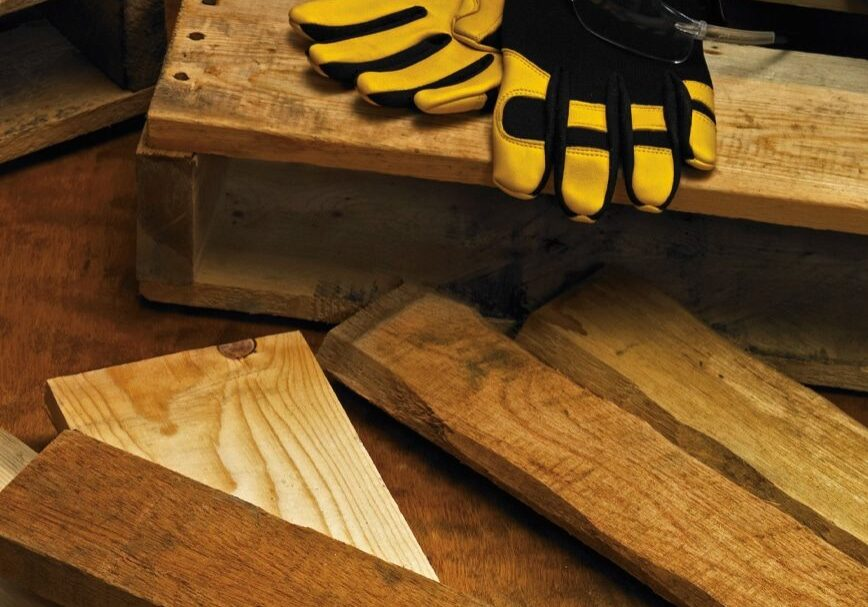 new pallets with safety gloves and goggles